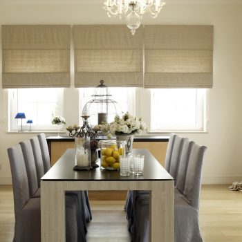 beige roman blinds in a modern dining room