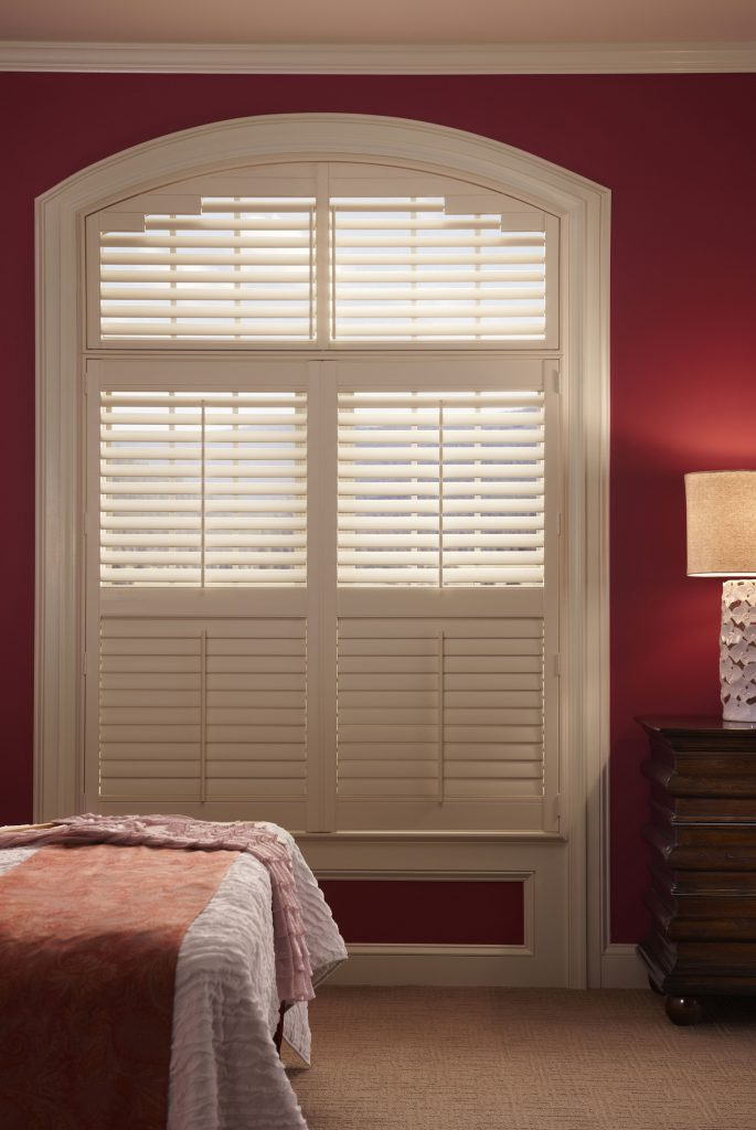 white wooden window shutters over a large bedroom window