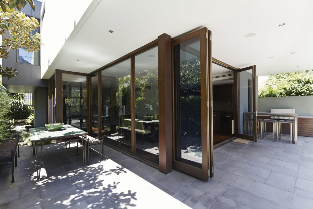 Bi fold doors opening to rear courtyard of contemporary home